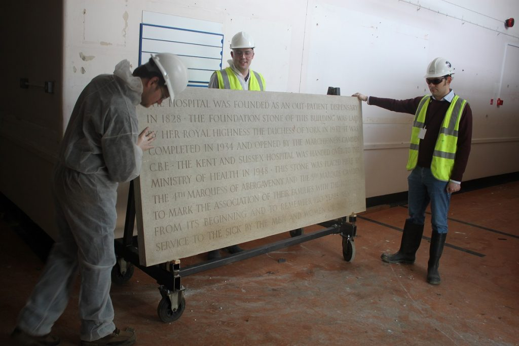 An image of an Antique Plaque after restoration being safely transported to a new home.